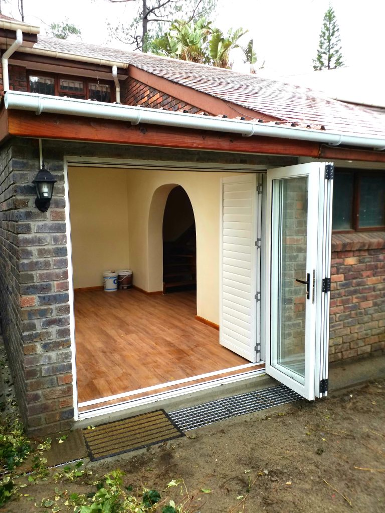 Glass bi-fold doors and aliminium shutters.